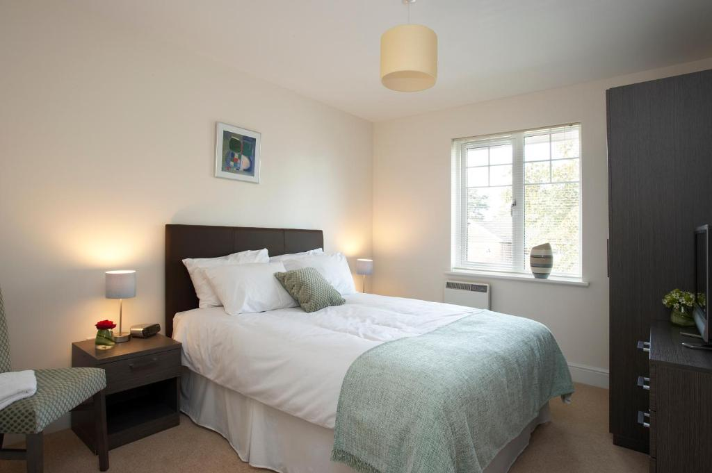 A bed or beds in a room at SACO Farnborough