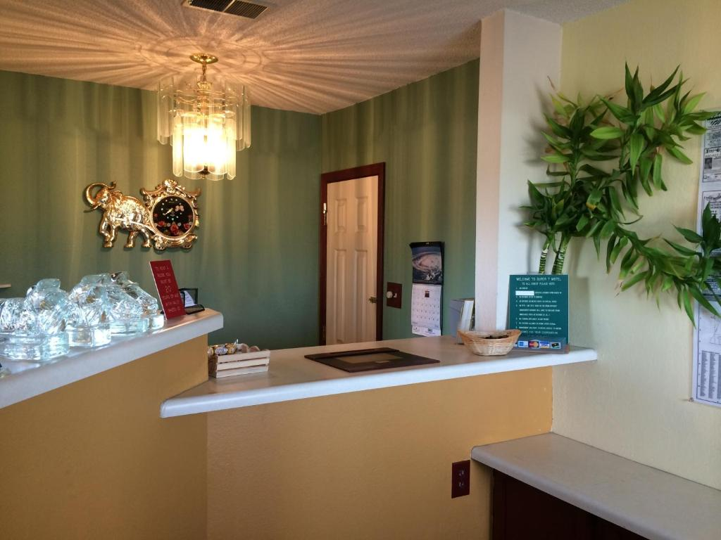 The lobby or reception area at Super 7 Motel