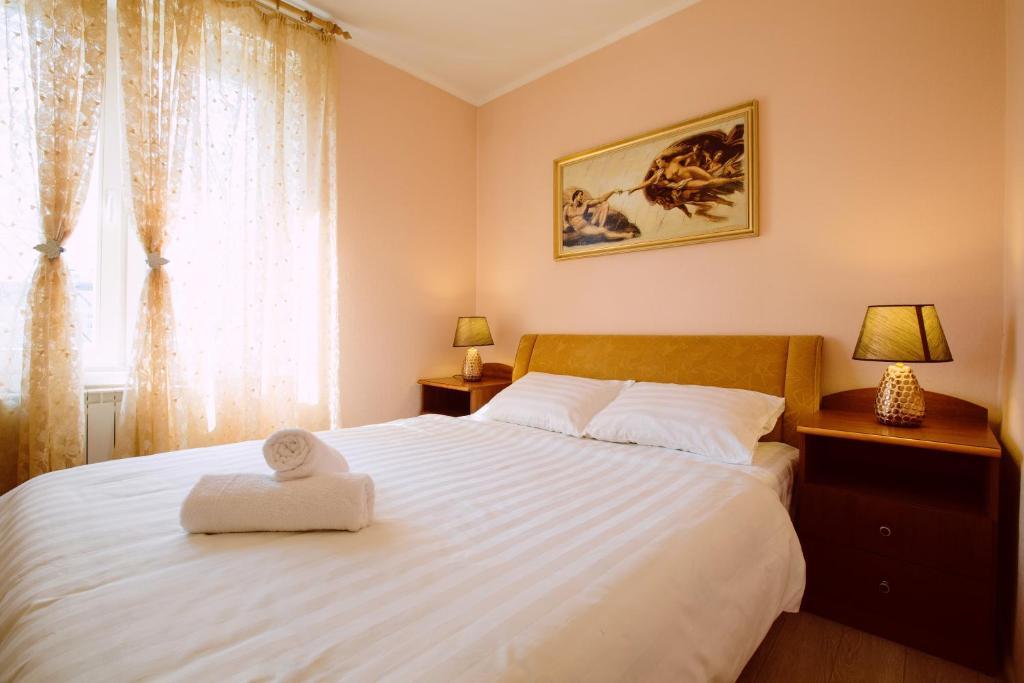 Кровать или кровати в номере ApartLux on Krasnaya Presnya
