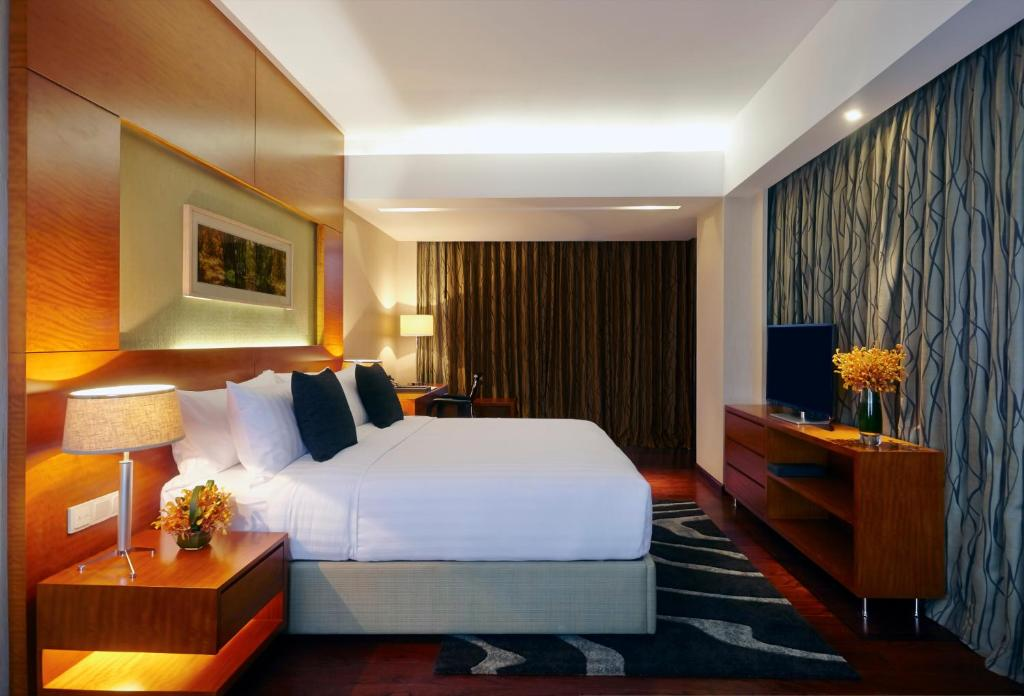A bed or beds in a room at Amari Dhaka