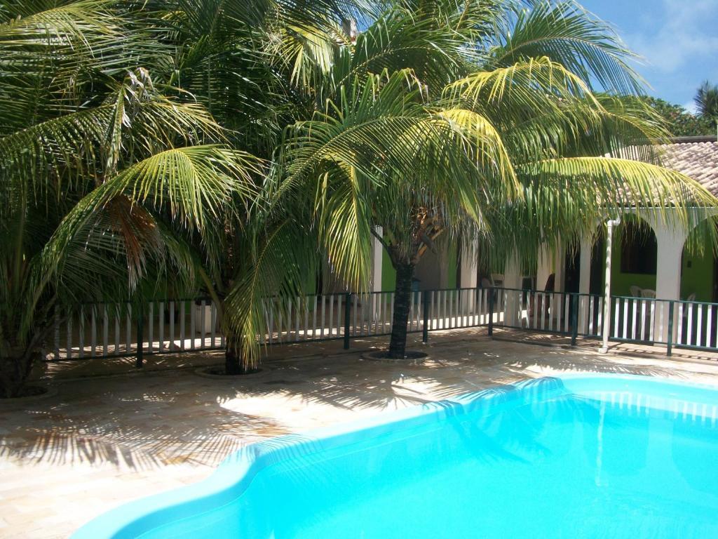 The swimming pool at or close to Pousada Ricardinho do Frances