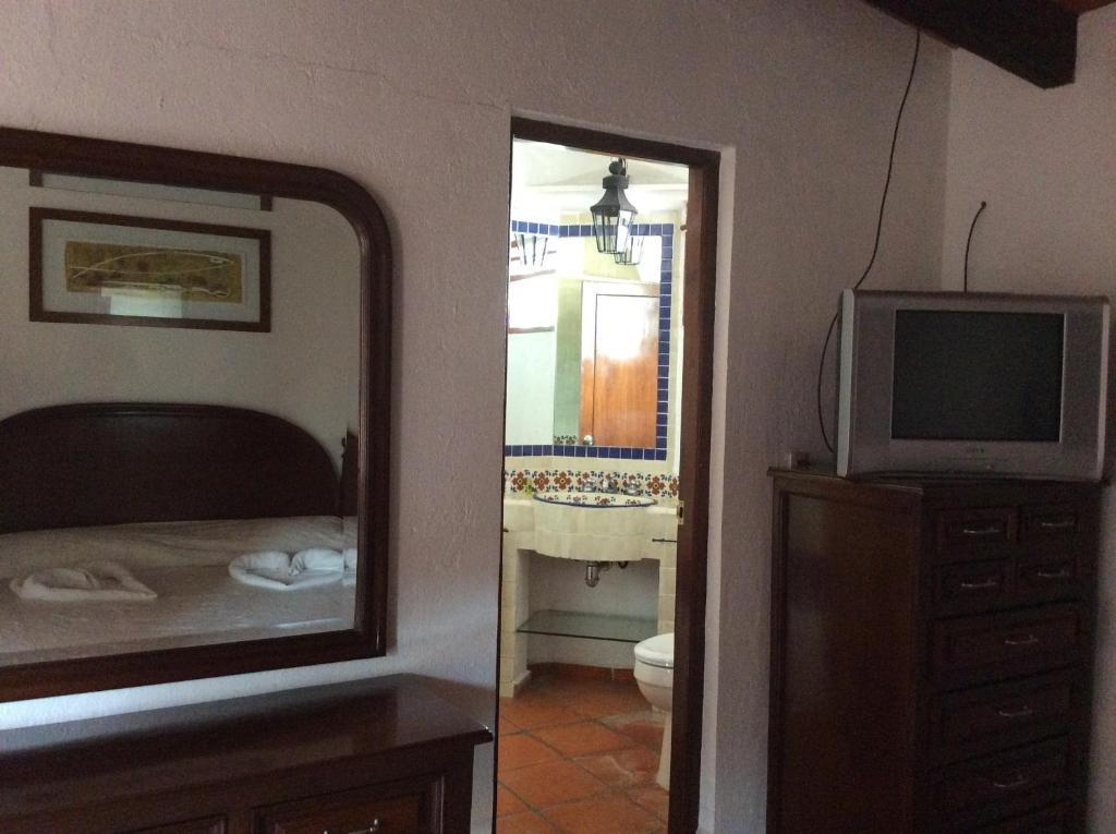 A television and/or entertainment center at Meson de Santiago
