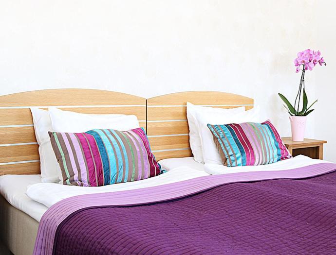 Säng eller sängar i ett rum på Hotell City