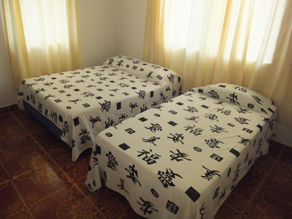 A bed or beds in a room at Hotel Beijing Internacional