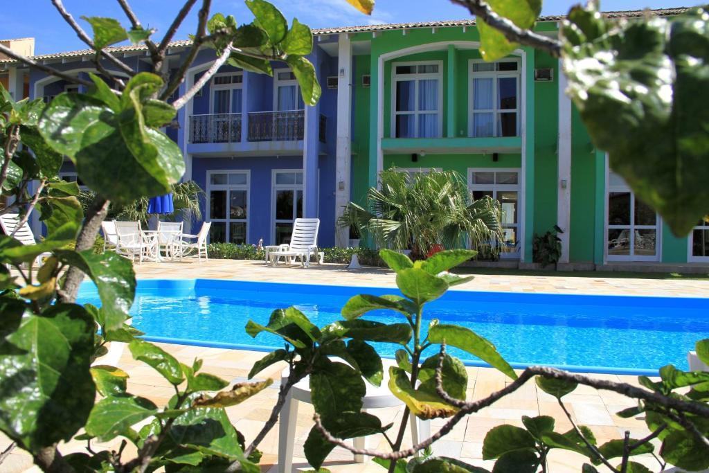 A piscina localizada em Hotel Porto de Paz - Shantiniketan ou nos arredores