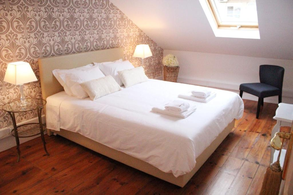 A bed or beds in a room at The Sky Lofts Lisbon - Guesthouse