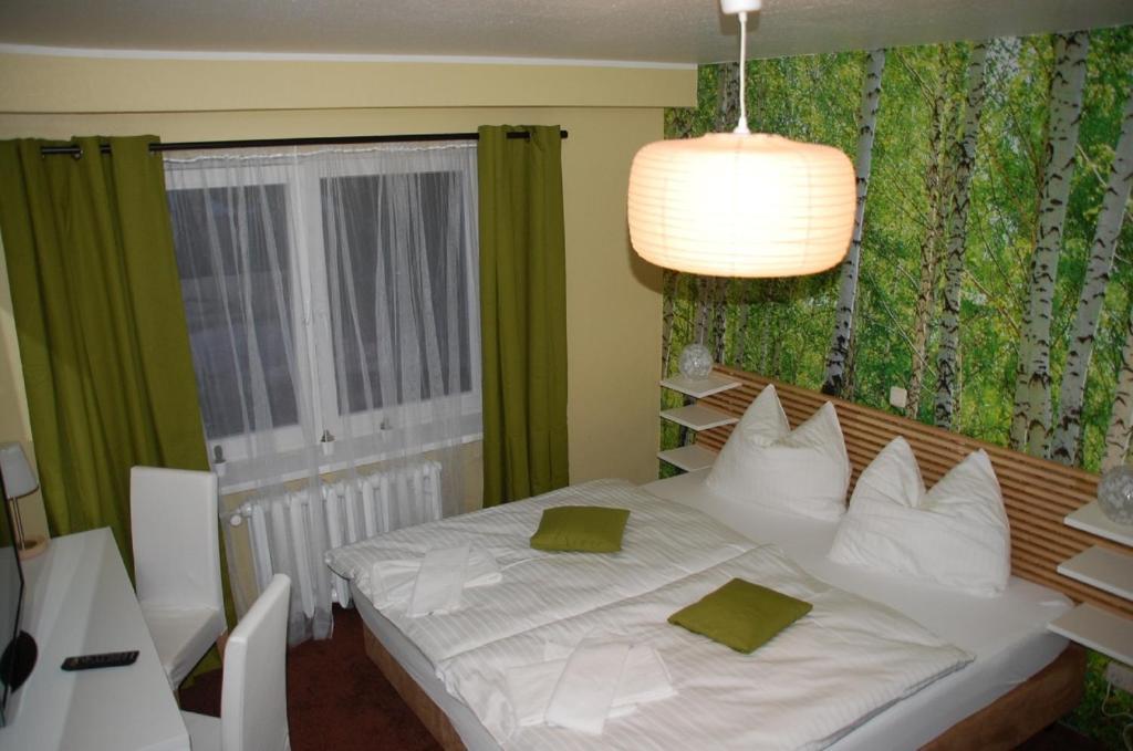 Ein Bett oder Betten in einem Zimmer der Unterkunft CASILINO Hotel A 24 Wittenburg