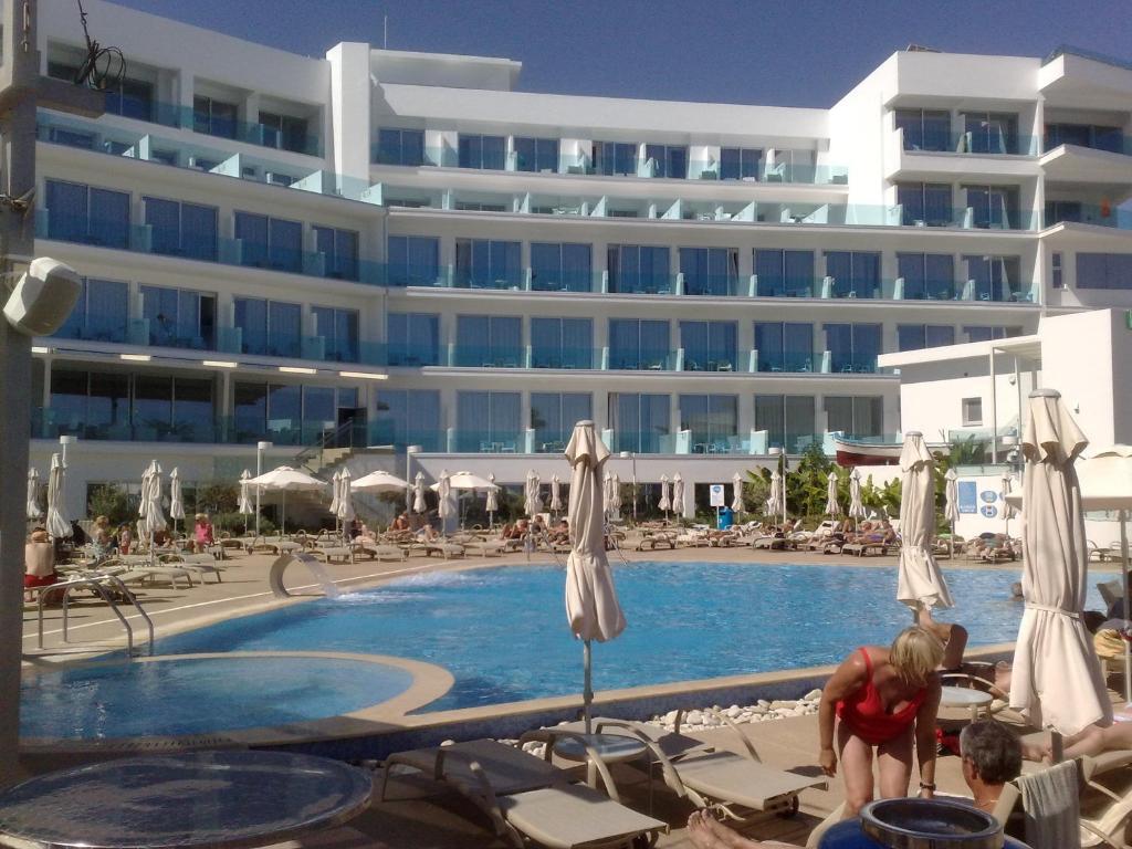 The swimming pool at or near Vrissaki Beach Hotel