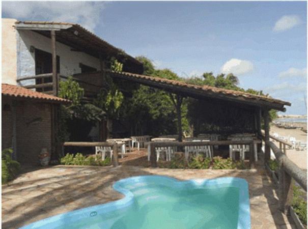 A piscina localizada em Pousada Vira Sol ou nos arredores