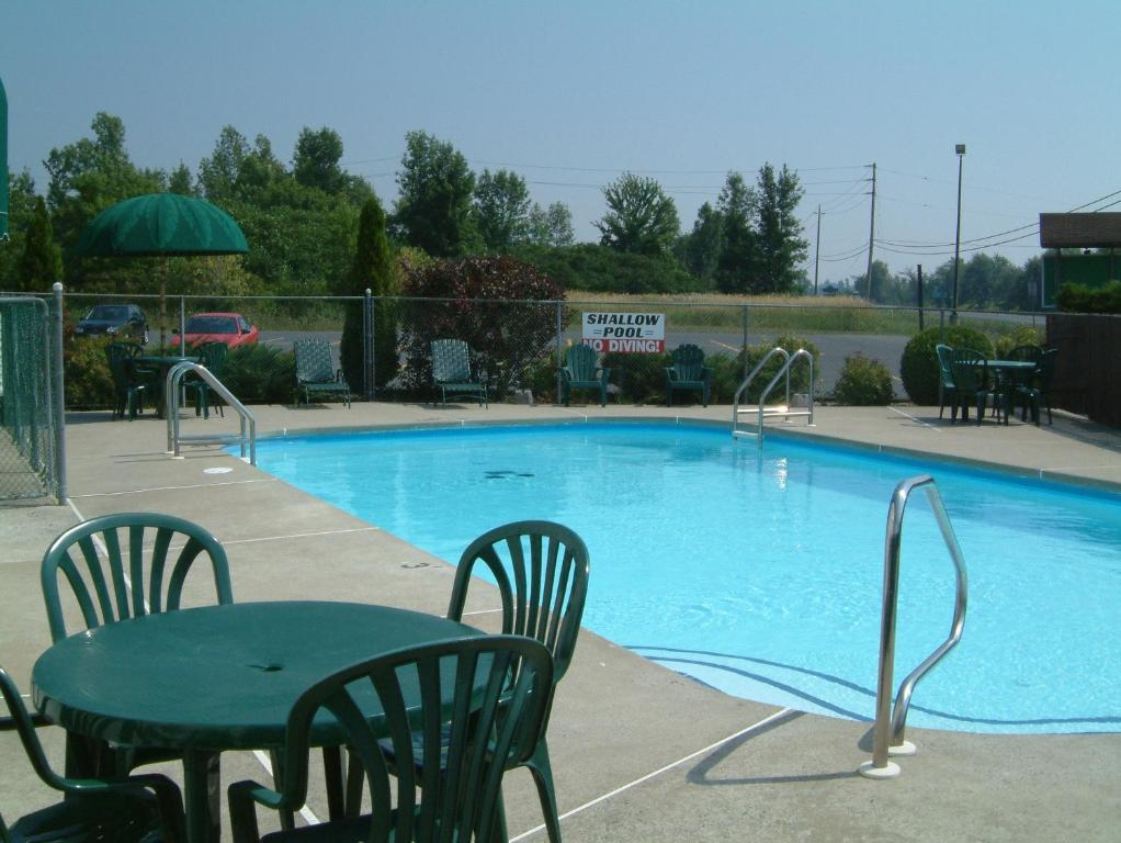 The swimming pool at or near McIntosh Country Inn & Conference Centre