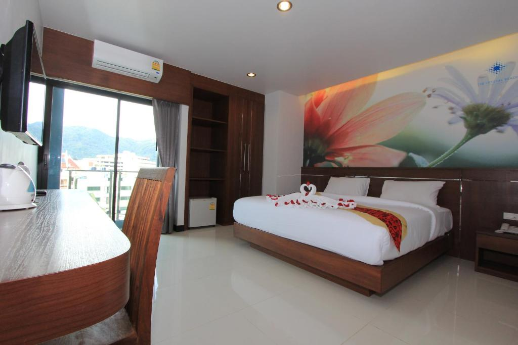 A bed or beds in a room at The Crystal Beach Hotel