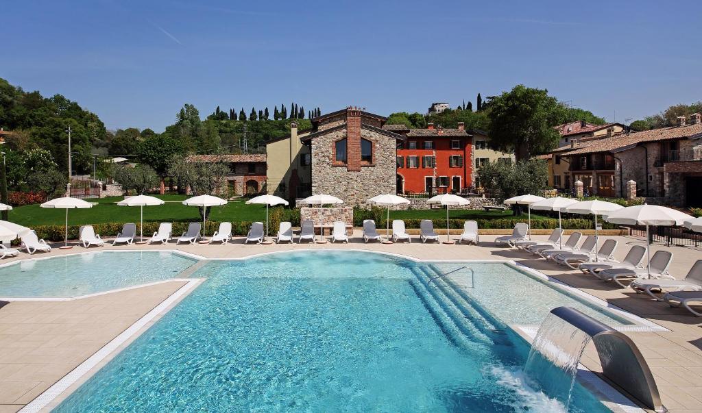 The swimming pool at or near Residence Borgo Mondragon