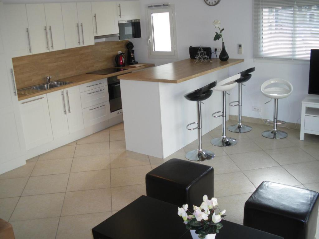 A kitchen or kitchenette at Residence Gameau