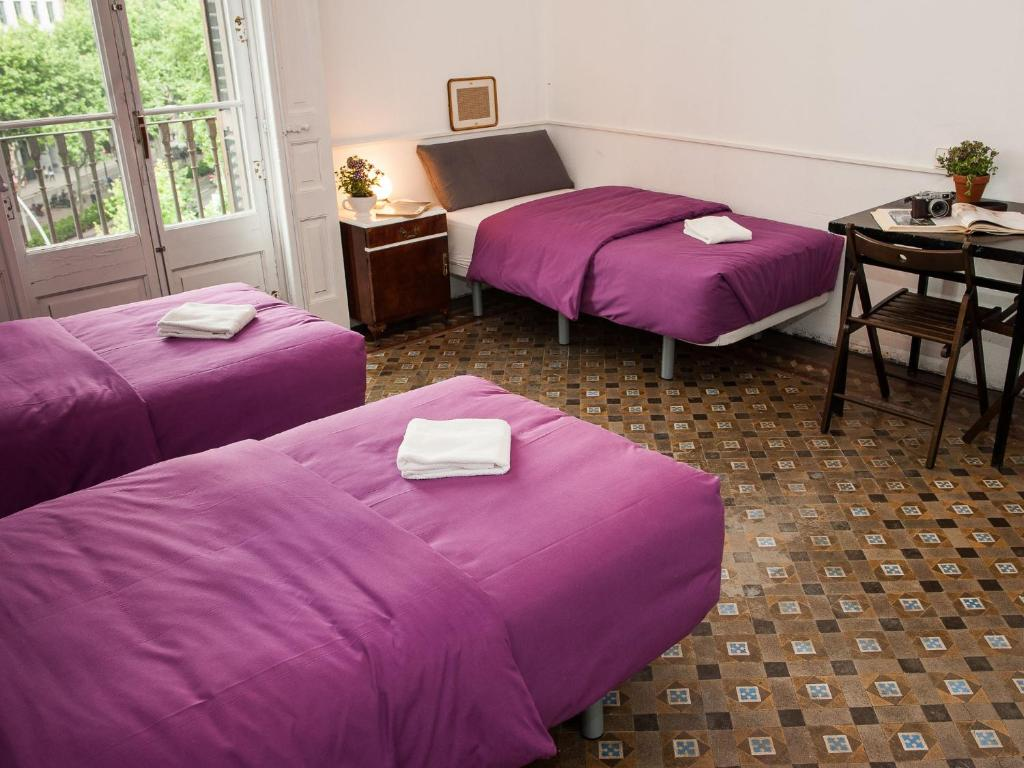 A bed or beds in a room at El Puchi Barcelona