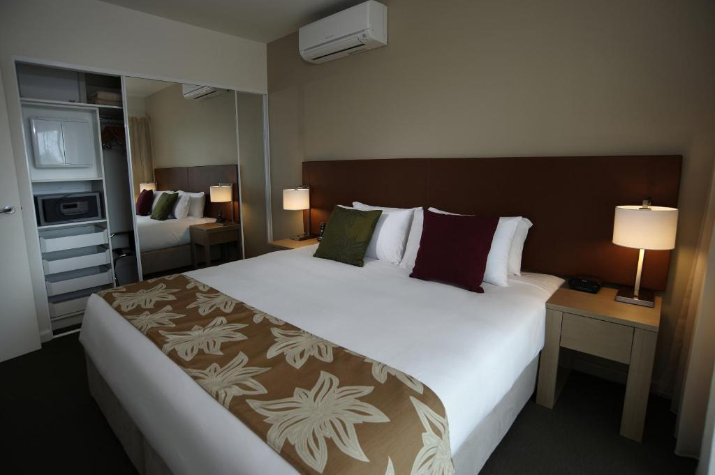 A bed or beds in a room at Quest Palmerston - Darwin