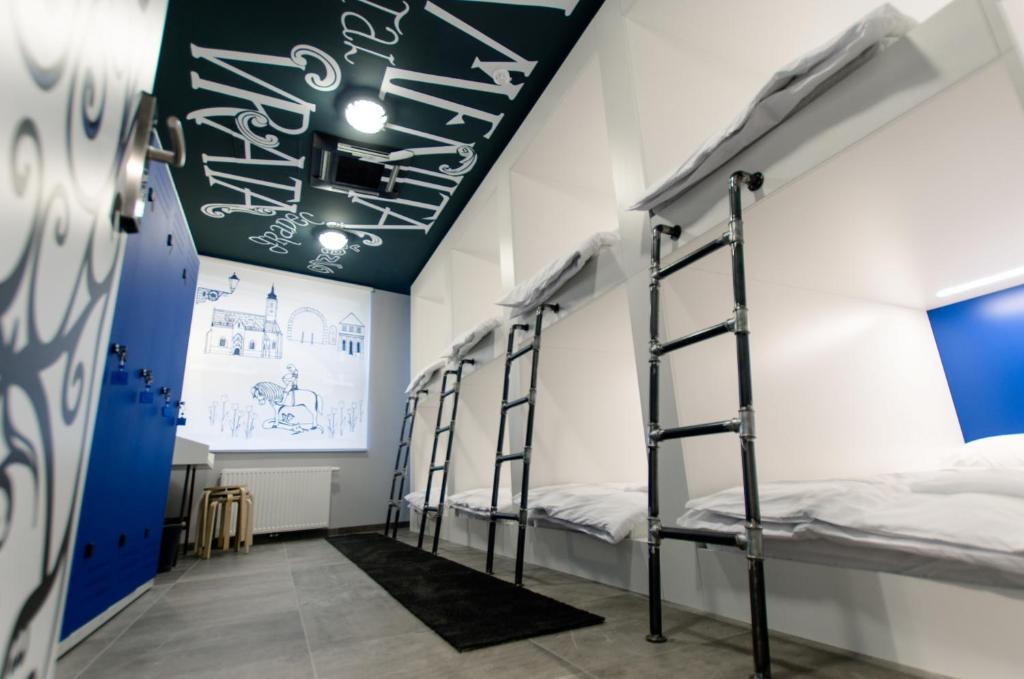 A bunk bed or bunk beds in a room at Main Square Hostel