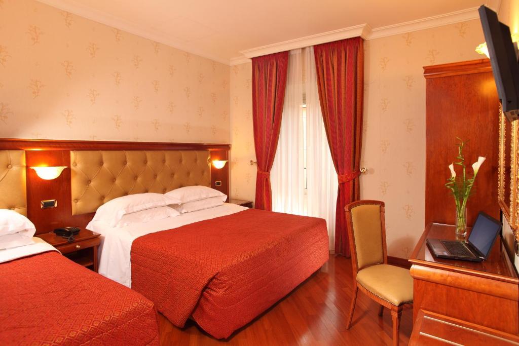 Un ou plusieurs lits dans un hébergement de l'établissement Hotel Serena