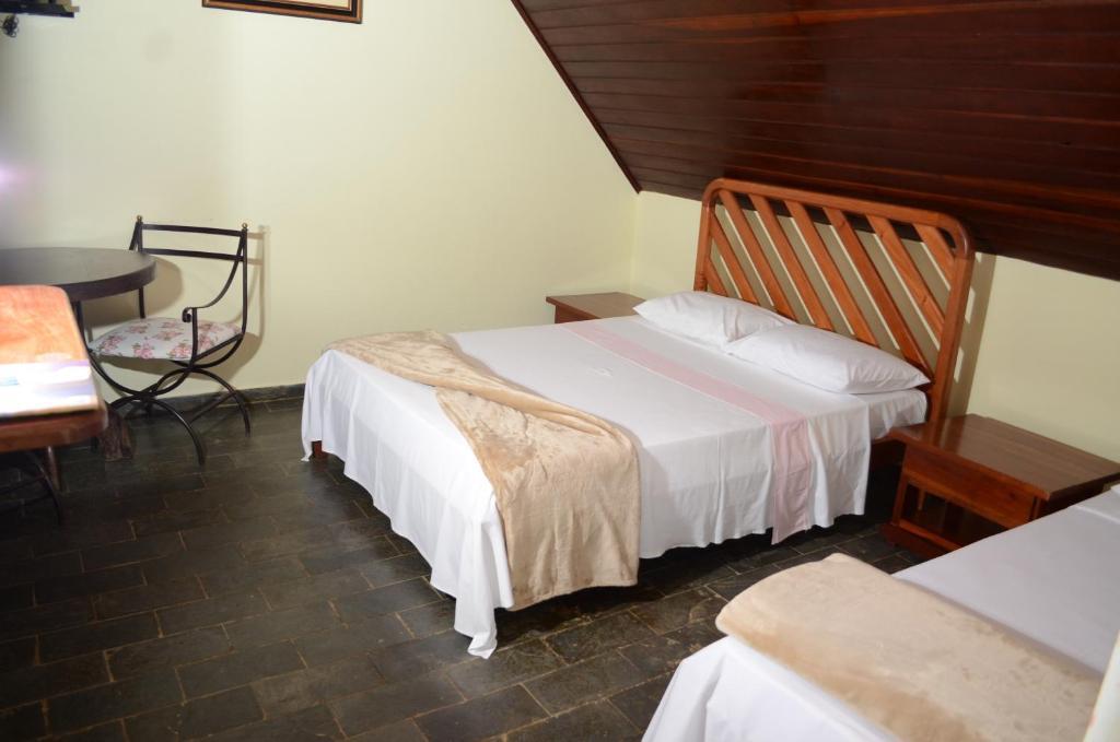 Cama ou camas em um quarto em Pousada Chalés da Estalagem