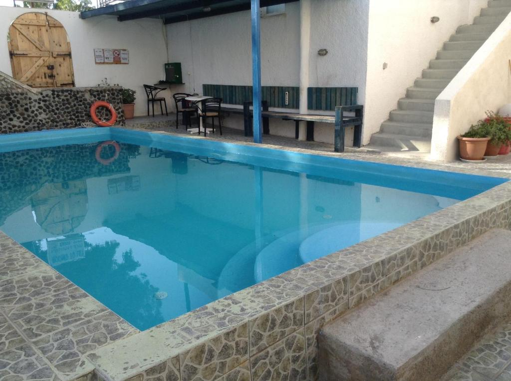 The swimming pool at or near Katerina & John's Hotel