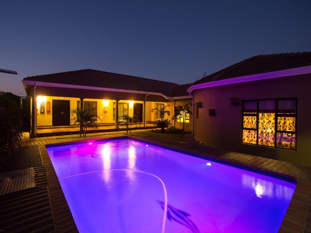 The swimming pool at or near Elegant & Exclusive Boutique GuestHouse