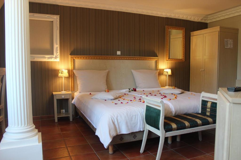 Ein Bett oder Betten in einem Zimmer der Unterkunft Akzent Hotel Borchers