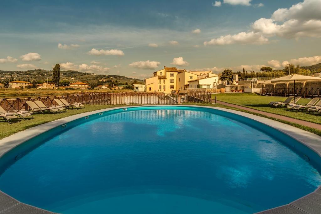 The swimming pool at or near Hotel Mulino Di Firenze