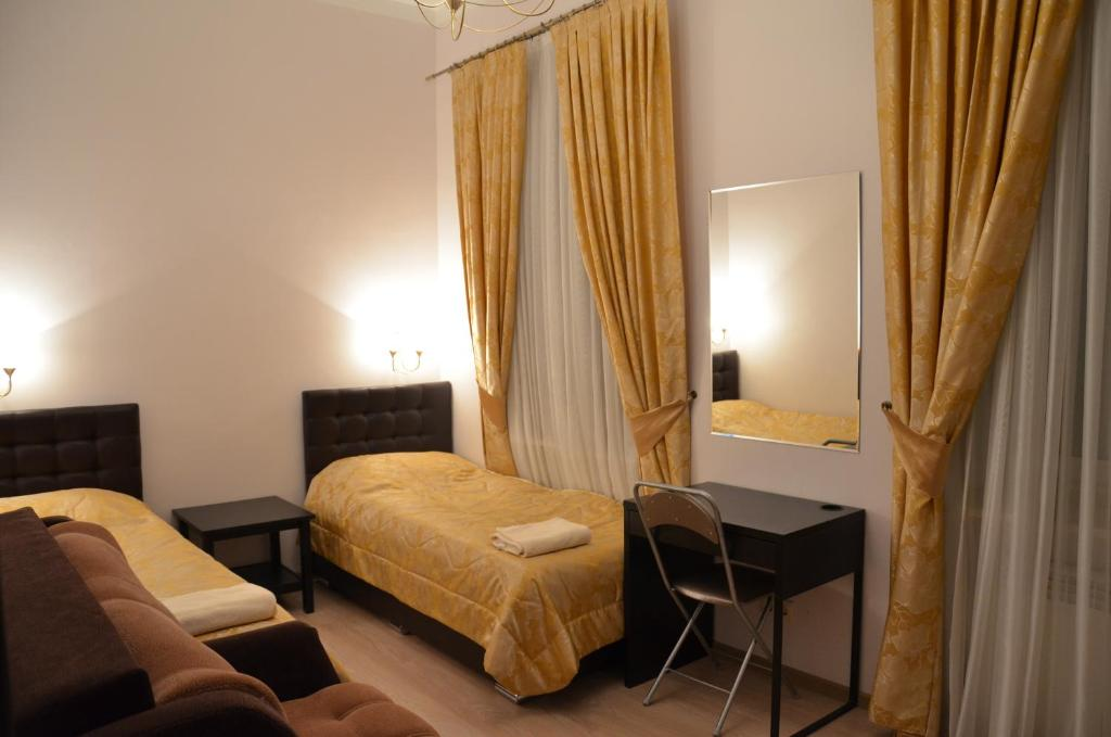 Кровать или кровати в номере Гостевой дом Amirus