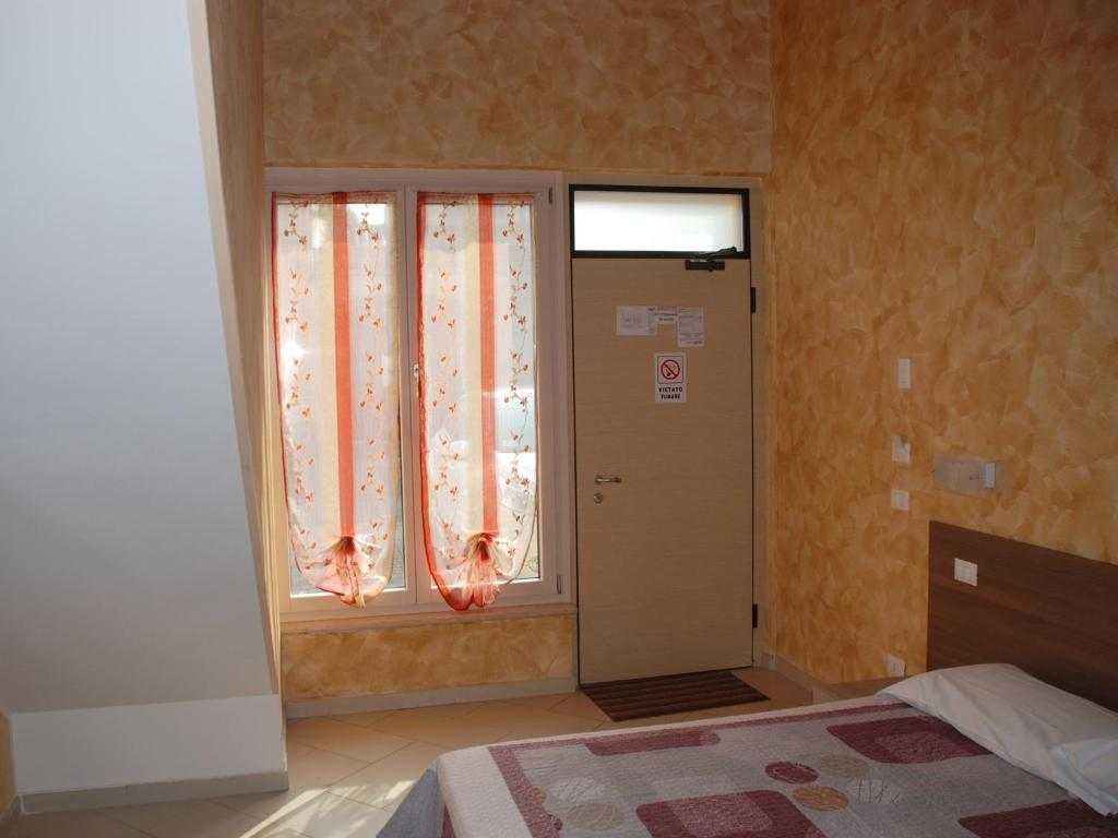 A bed or beds in a room at Affittacamere Matteo