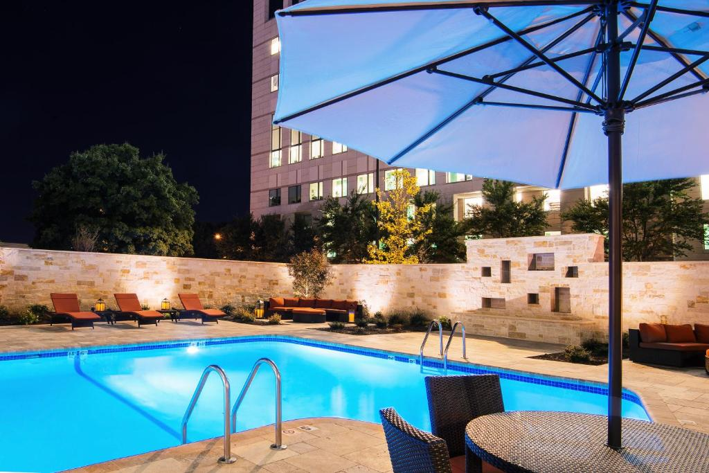 The swimming pool at or near Fairfield Inn & Suites by Marriott Charlotte Uptown