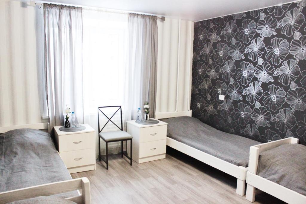 Кровать или кровати в номере Stars Хостел