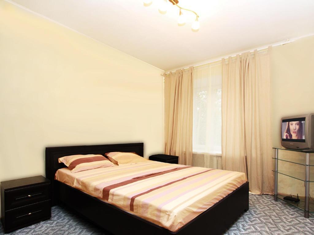Кровать или кровати в номере ApartLux Красносельская