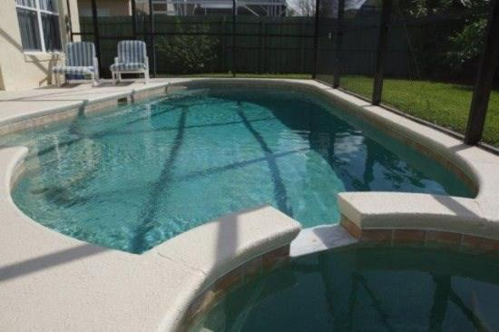 The swimming pool at or close to Arrow Creek Villa IC804