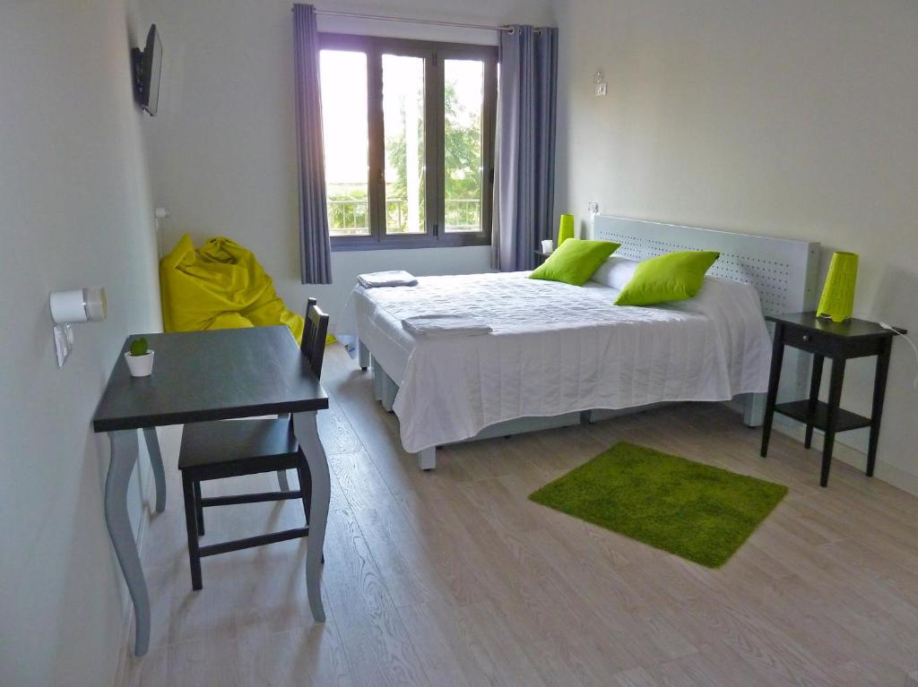 A bed or beds in a room at BcnSportHostels