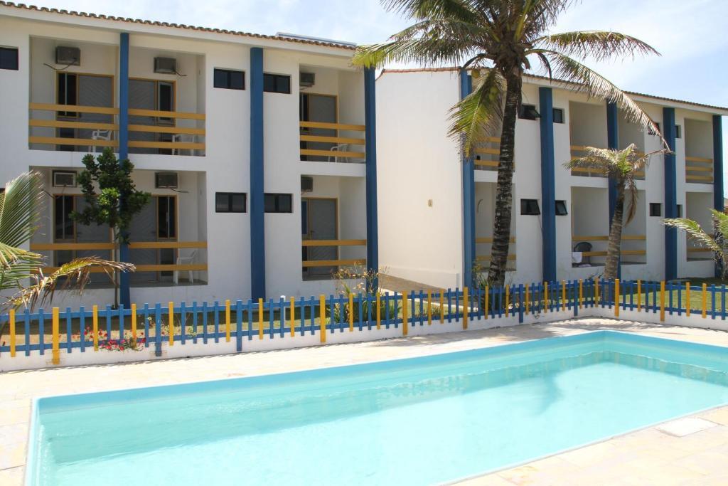 The swimming pool at or near Pousada Solar das Flores