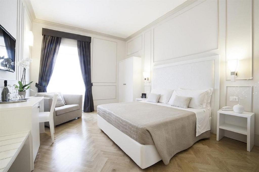 A bed or beds in a room at Residenza Scipioni Luxury B&B