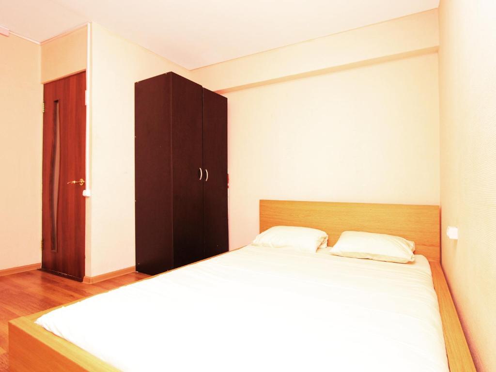 Кровать или кровати в номере ApartLux Речной