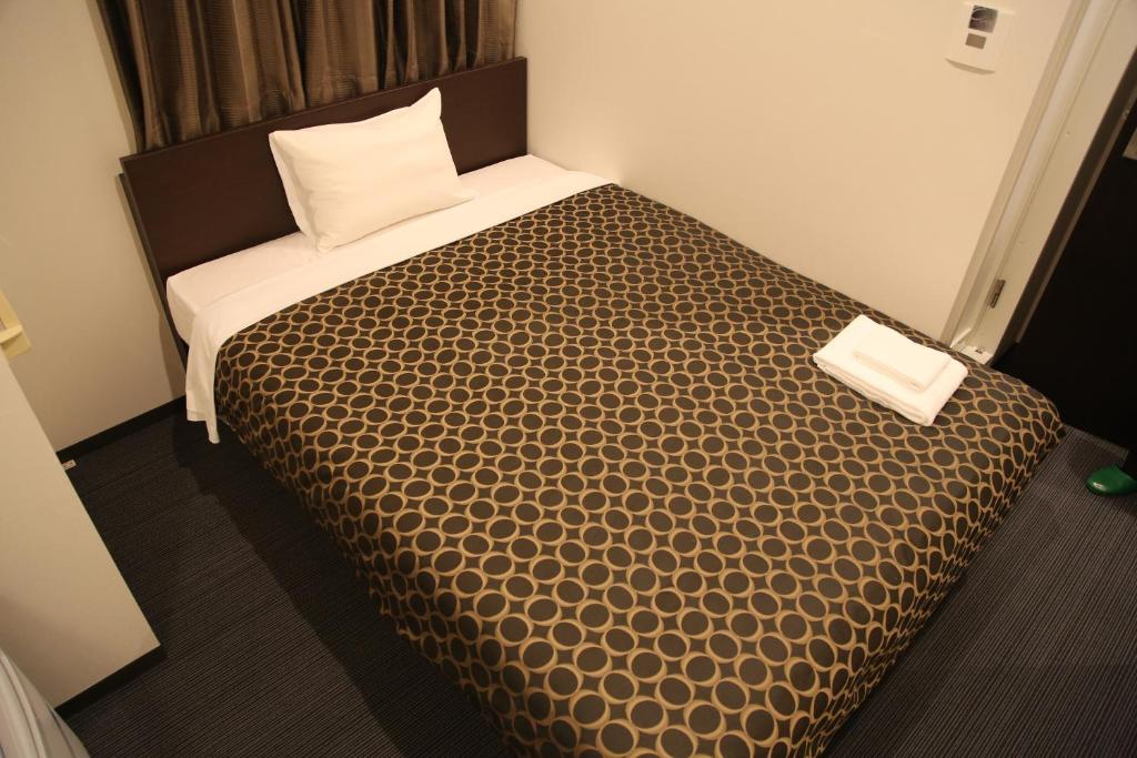 Tempat tidur dalam kamar di Hotel Excellence Kyoto Ekimae