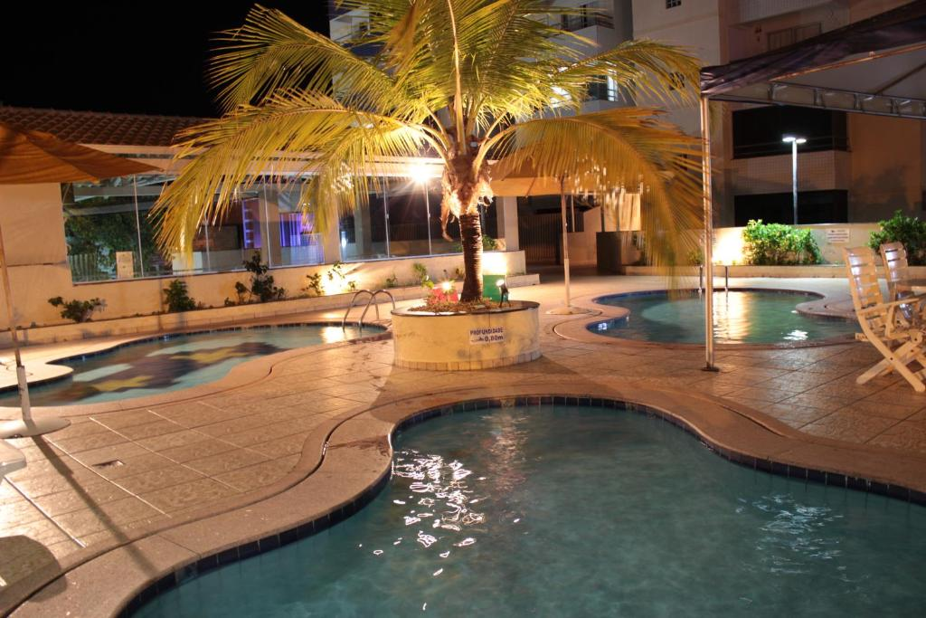 The swimming pool at or near Apartamento Paradise Residence
