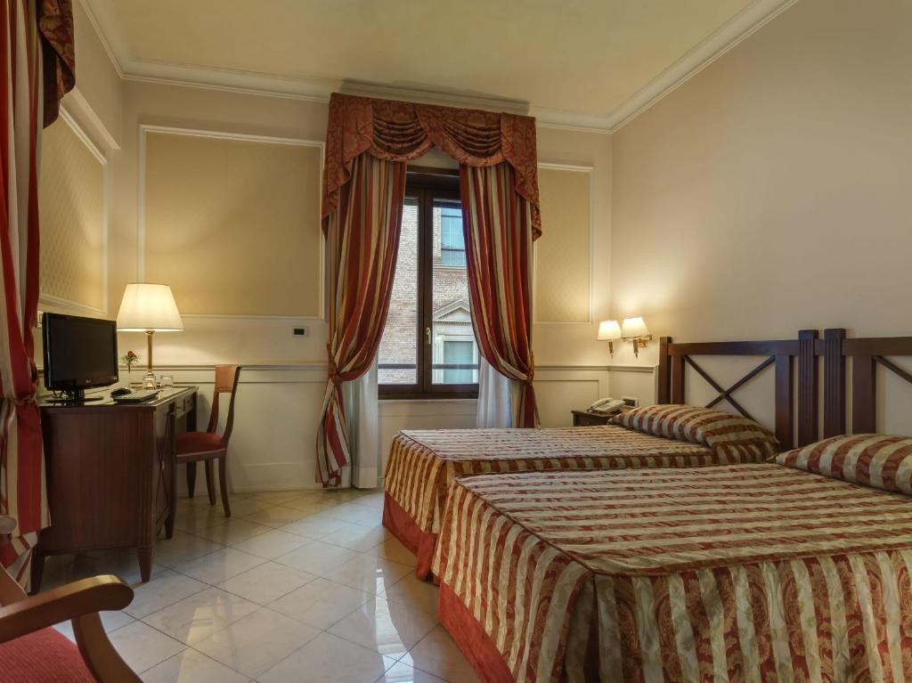 A bed or beds in a room at Palazzo Cardinal Cesi