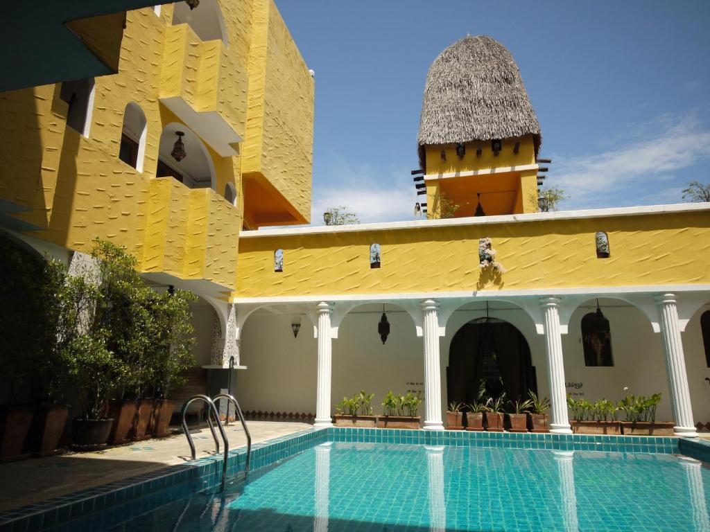 The swimming pool at or near Riad Hua Hin