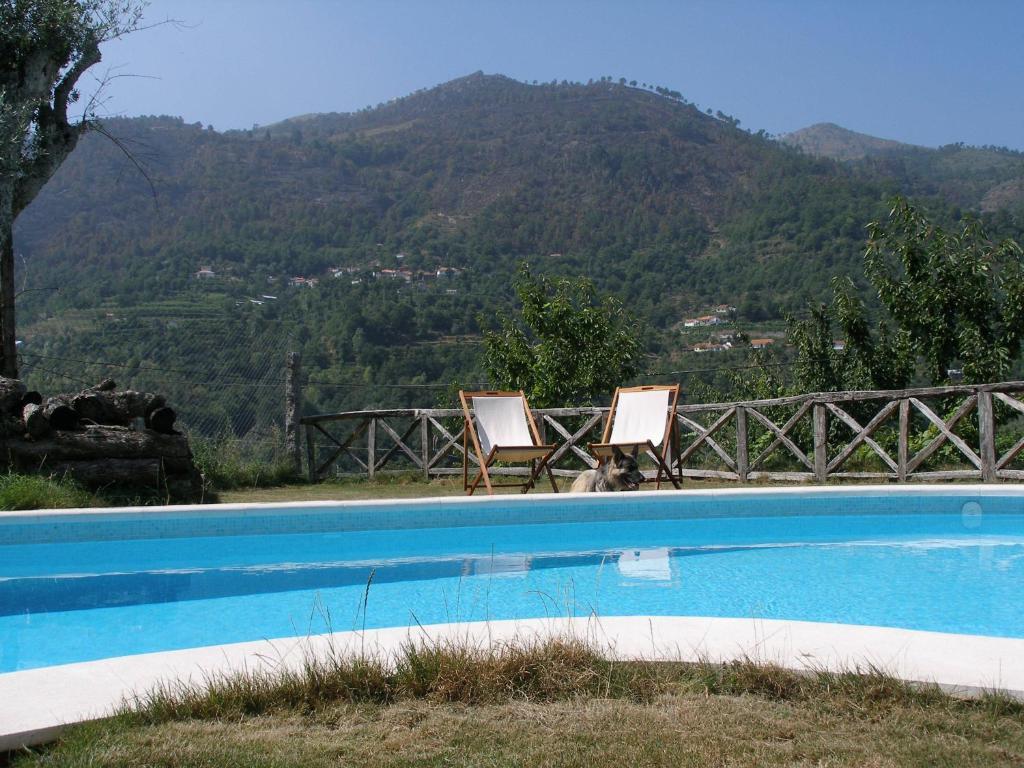 The swimming pool at or near Casa do Moleiro