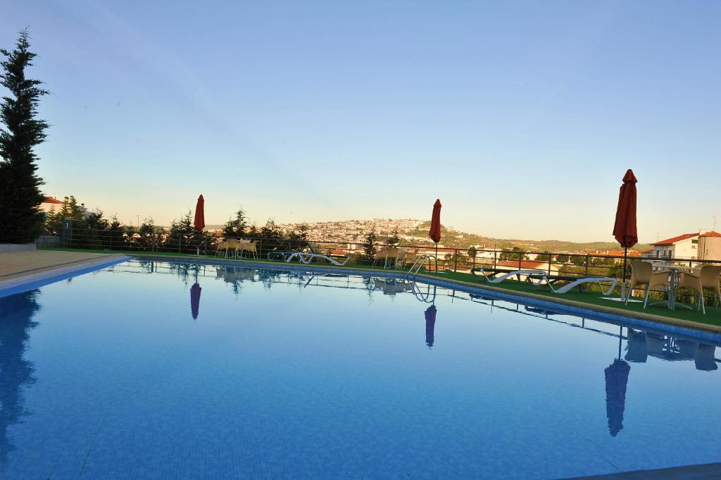 The swimming pool at or near Hotel Lusitania Congress & Spa