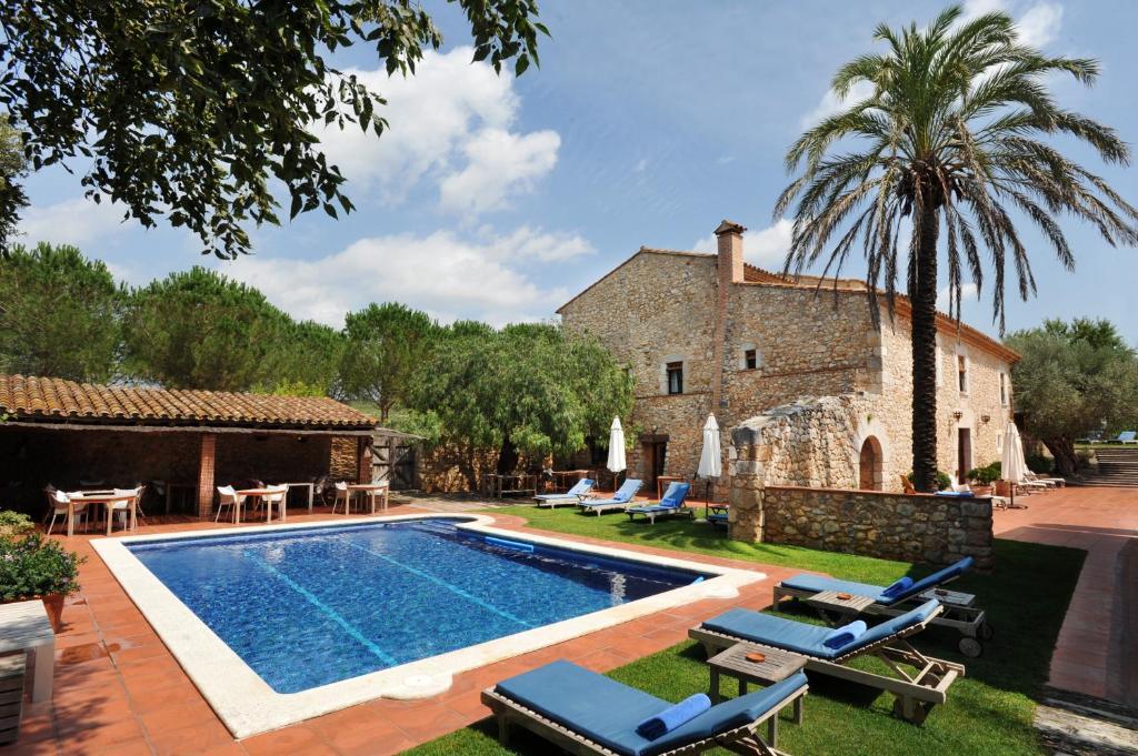 The swimming pool at or close to Mas Falgarona Hotel Boutique & SPA