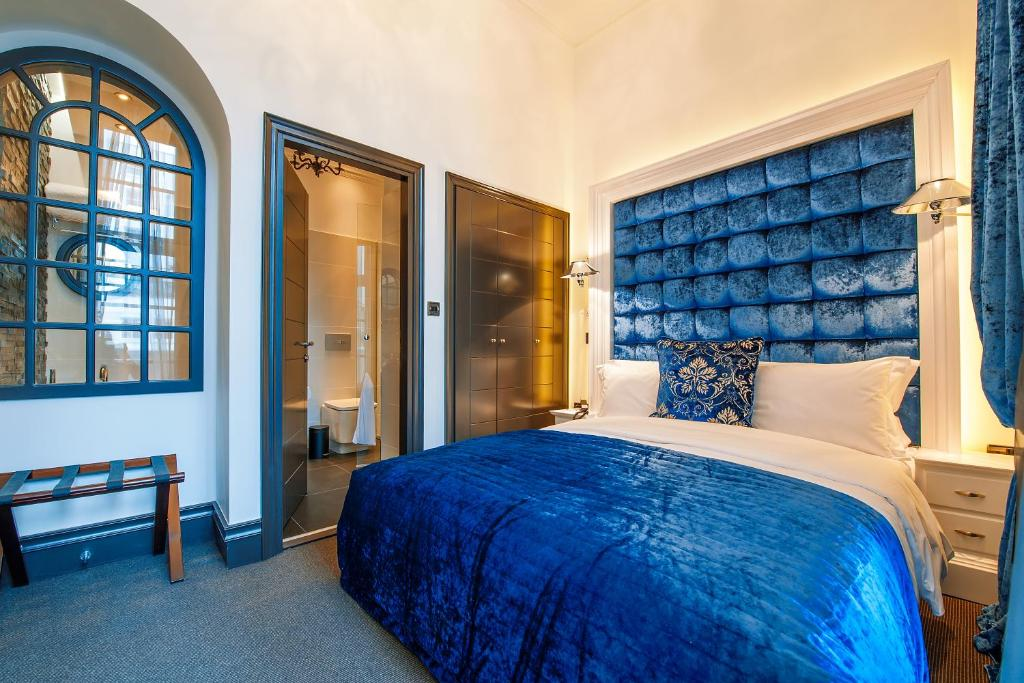 A bed or beds in a room at The Exhibitionist Hotel