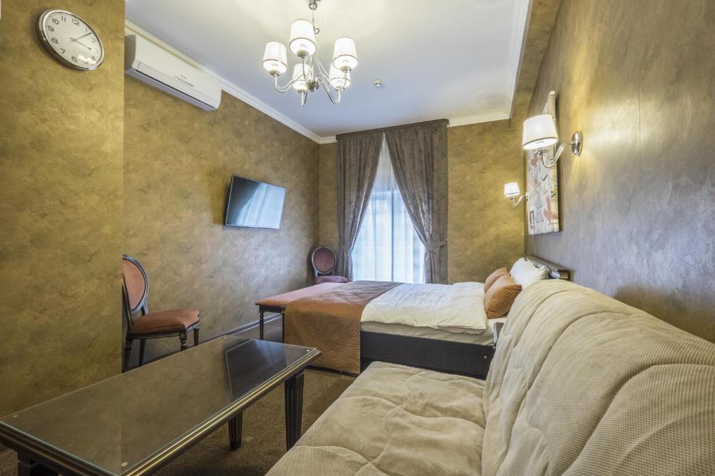 Кровать или кровати в номере Погости на Тульской