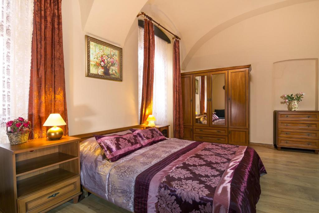 A bed or beds in a room at Penzión Grand