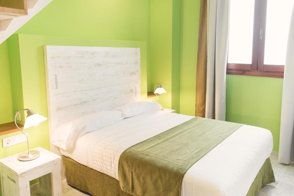 Кровать или кровати в номере Ad Hoc Carmen