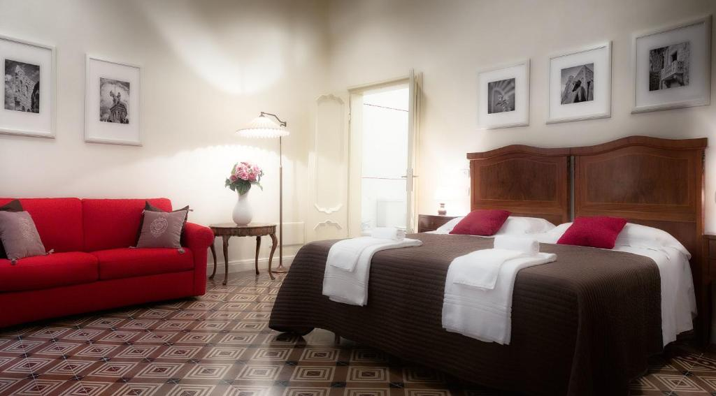 A bed or beds in a room at Palazzo Cerù Bed and Breakfast