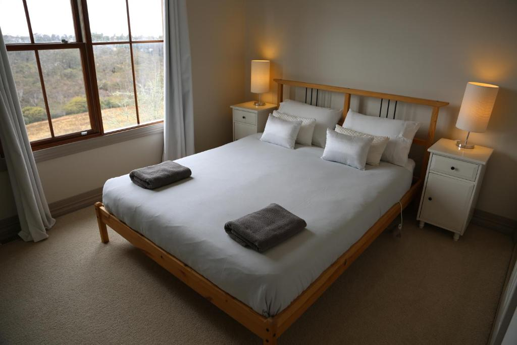 A bed or beds in a room at Ironstone Views