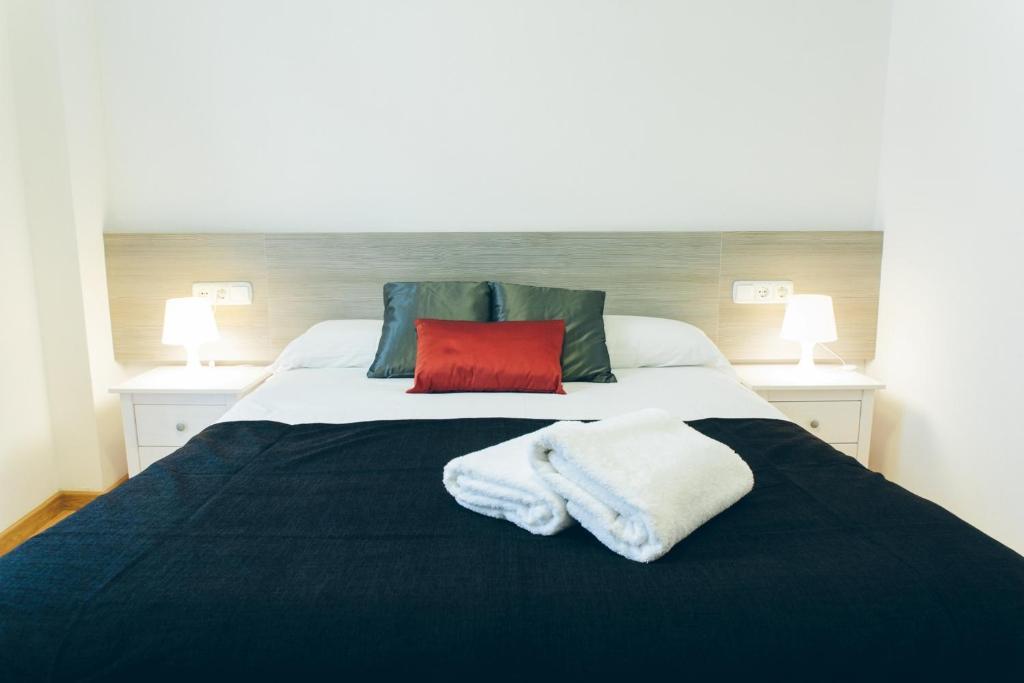 Кровать или кровати в номере The Lucky Flats - Artilleros